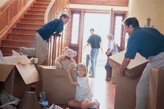 Family moving furniture for new floors
